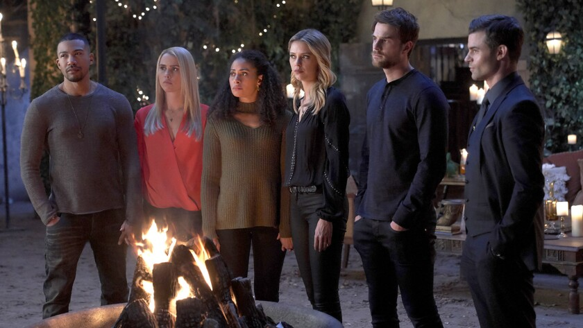 """Charles Michael Davis, left, Claire Hold, Christina Moses, Riley Voelkel, Nathaniel Buzolic and Daniel Gillies in """"The Originals"""" on The CW."""