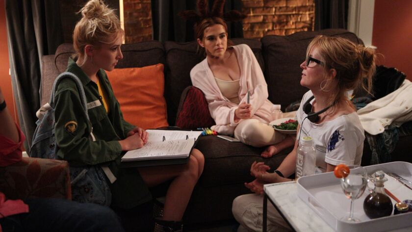 "(L-R) Madelyn Deutch, Zoey Deutch, and director Lea Thompson on the set of in ""The Year of Spectac"