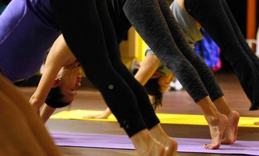 Lululemon said its fourth-quarter earnings beat estimates but that its recall of too-sheer pants would hurt fiscal 2013 results.