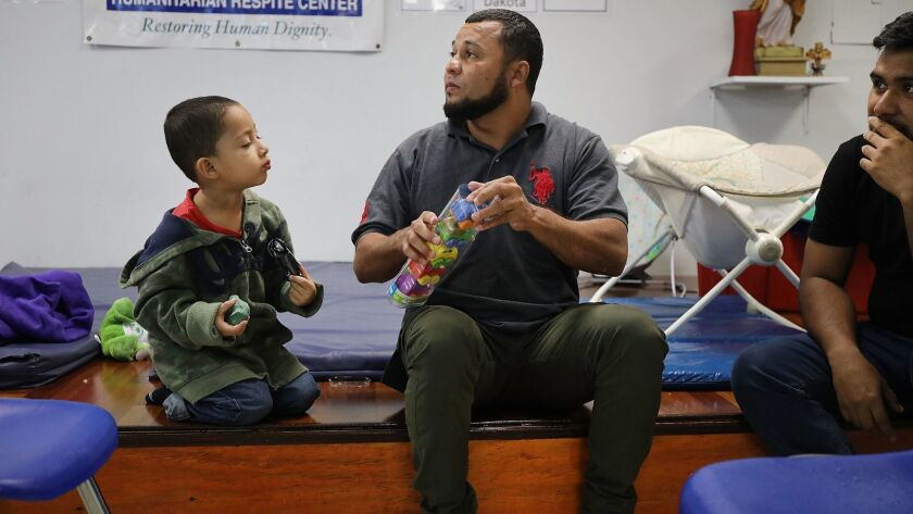A Honduran father and son at the Catholic Charities Humanitarian Respite Center in McAllen, Texas. The Trump administration is seeking court permission to hold more immigrant families in detention centers for extended periods after they are caught illegally crossing the border.