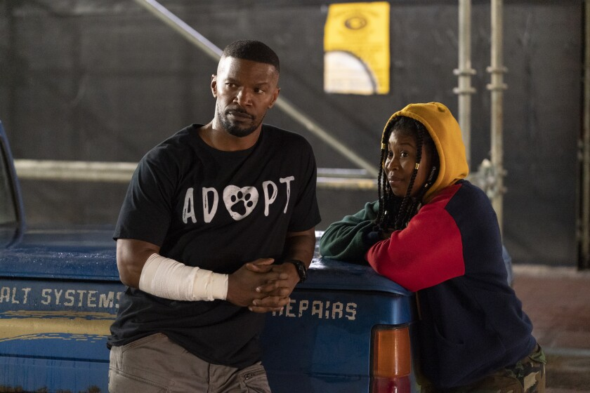 """Jamie Foxx and Dominique Fishback in the movie """"Project Power."""""""