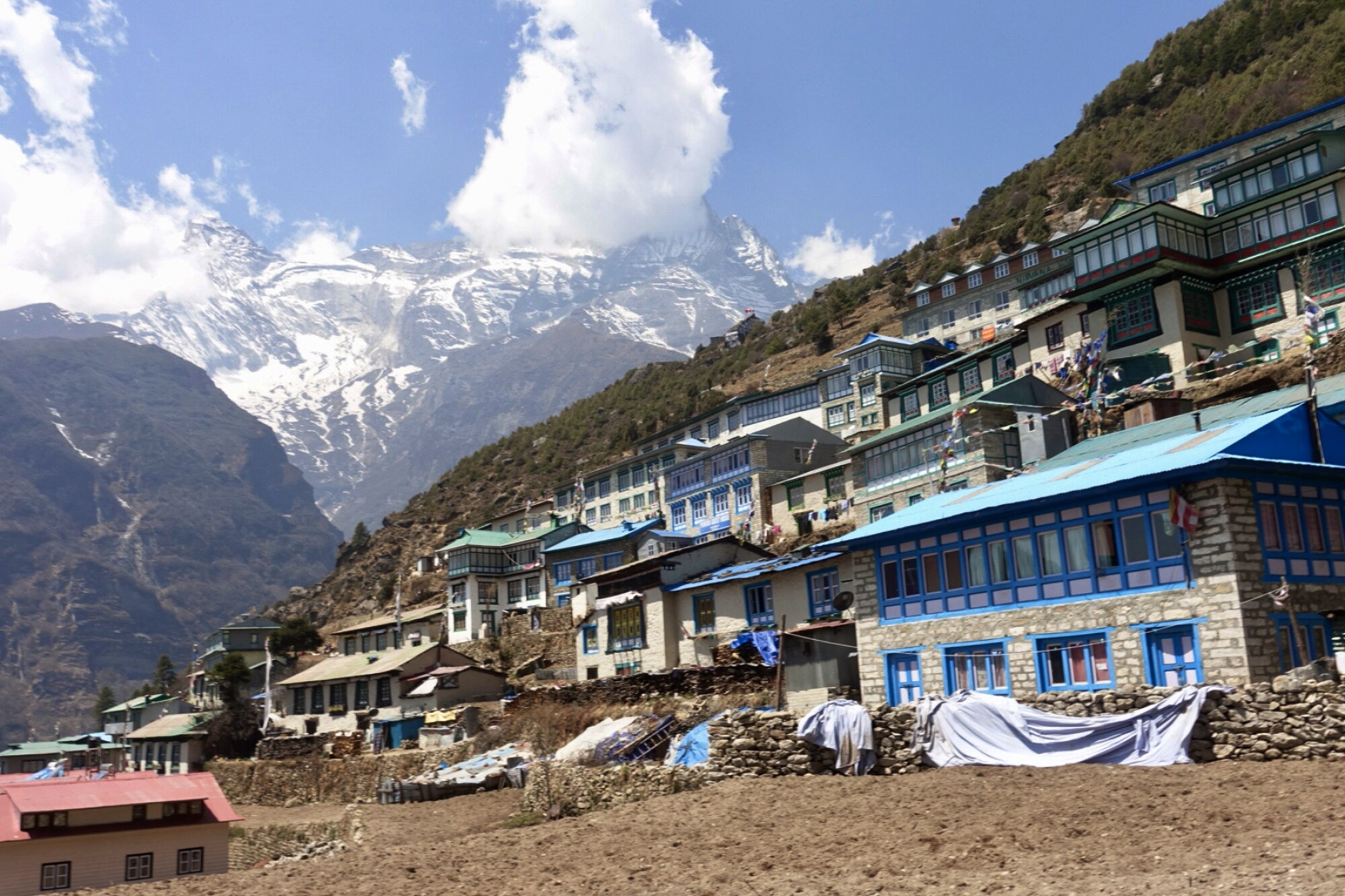 Modest buildings along a mountainside in the Himalayas