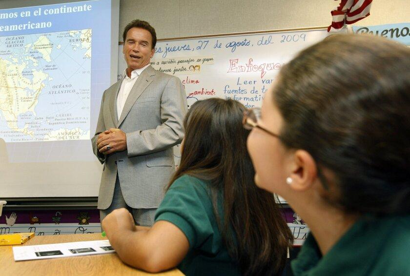 Fourth-grade students Elia Vega and Monique Ruiz (right) heard Gov. Arnold Schwarzenegger speak at the Chula Vista Learning Community Charter School. (K.C. Alfred / Union-Tribune)