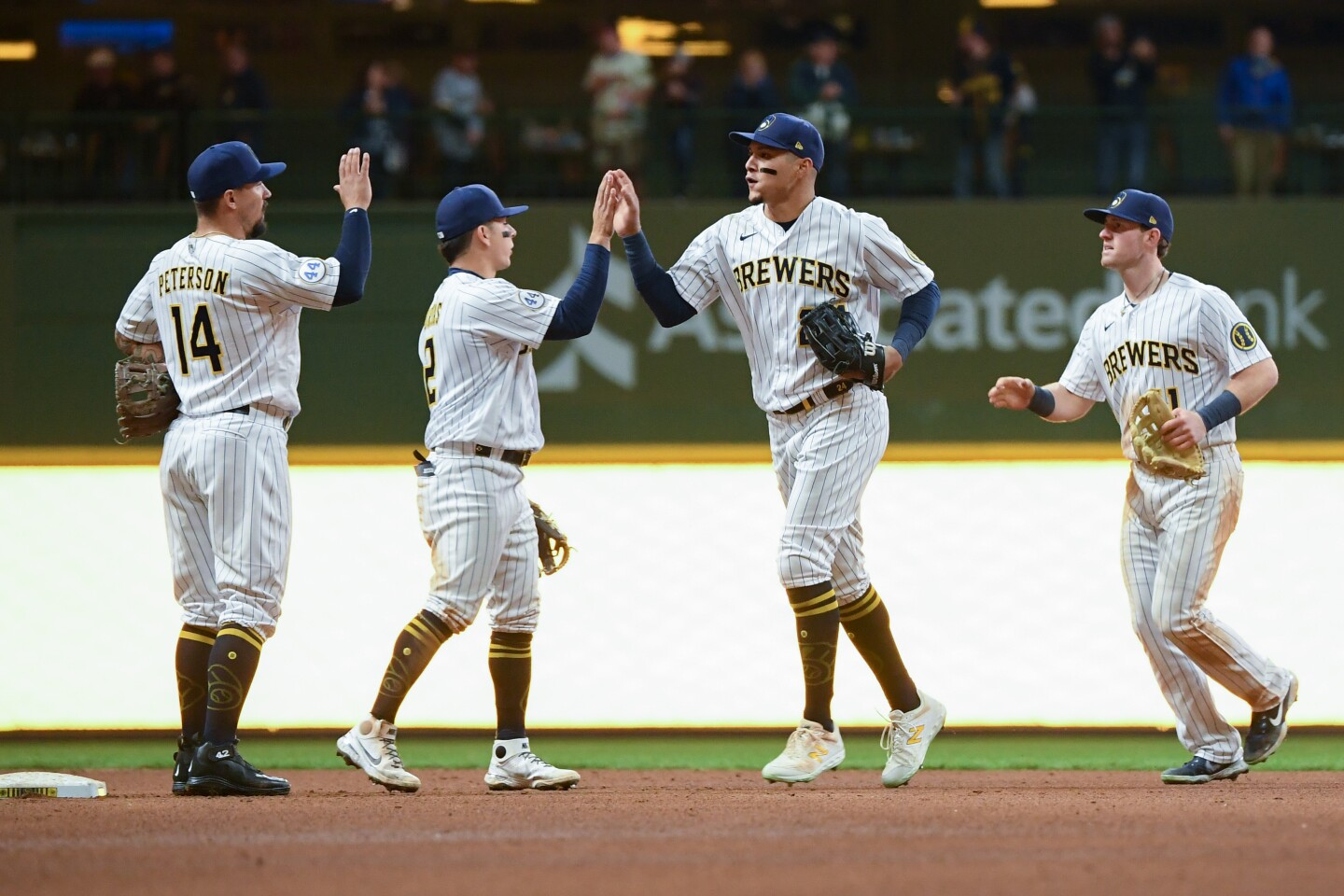 MILWAUKEE, WISCONSIN - APRIL 17: Avisail Garcia #24 of the Milwaukee Brewers and his teammates celebrate the team win against the Pittsburgh Pirates after the MLB game at American Family Field on April 17, 2021 in Milwaukee, Wisconsin. (Photo by Quinn Harris/Getty Images)