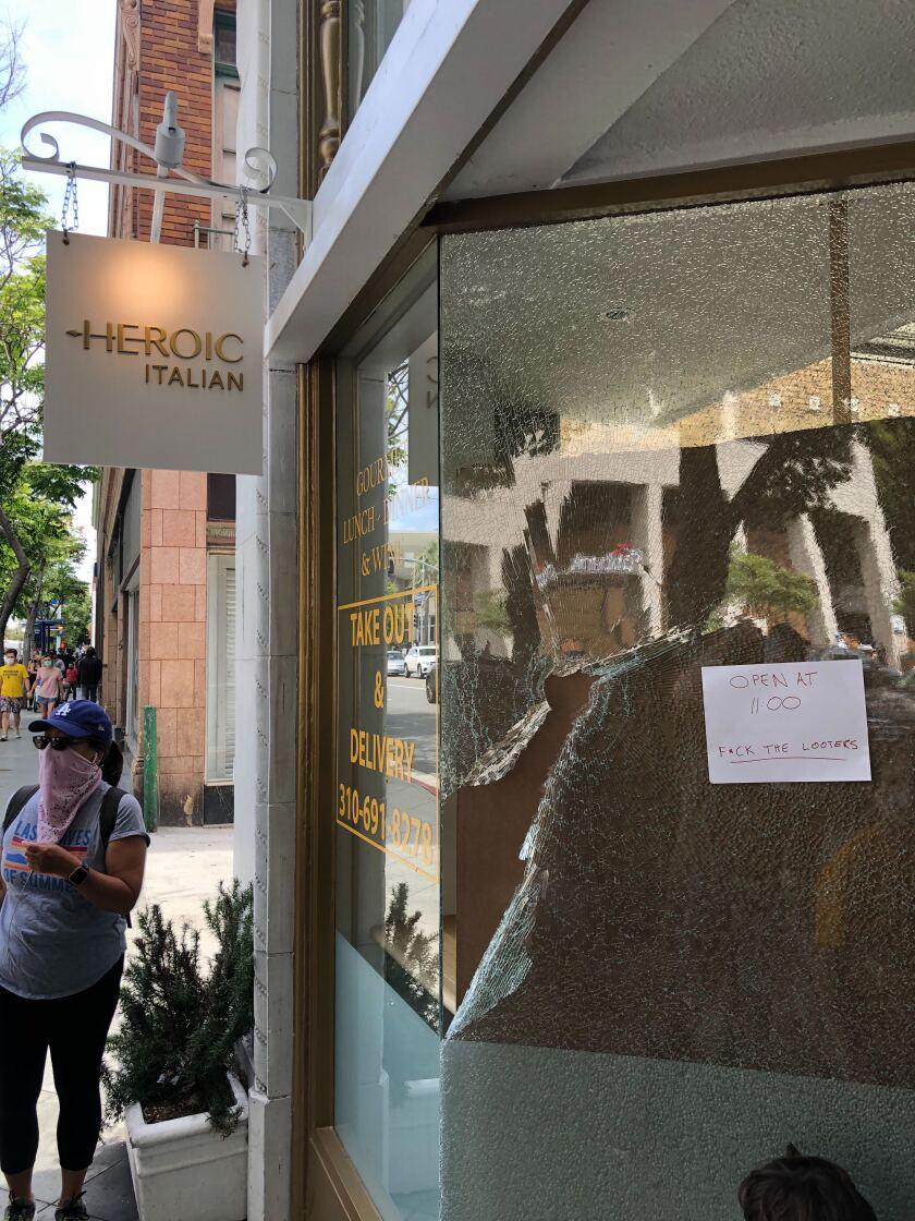 Heroic Deli in Santa Monica opens despite damage to its front window.