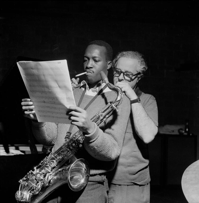 Saxophonist Hank Mobley and Alfred Lion, co-founder of the legendary Blue Note record label, prepare for a recording session in the jazzy documentary 'It Must Schwing: The Blue Note Story.'