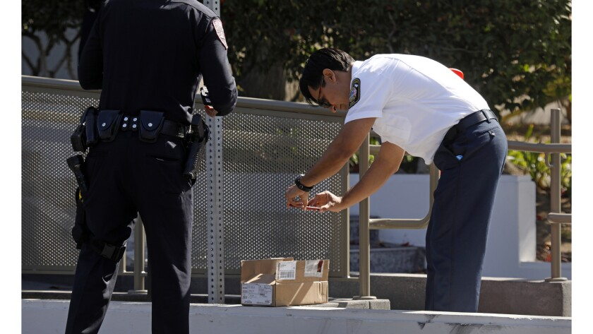 Police and fire officials investigate suspicious envelopes at the Los Angeles Times building on East Imperial Highway in El Segundo.
