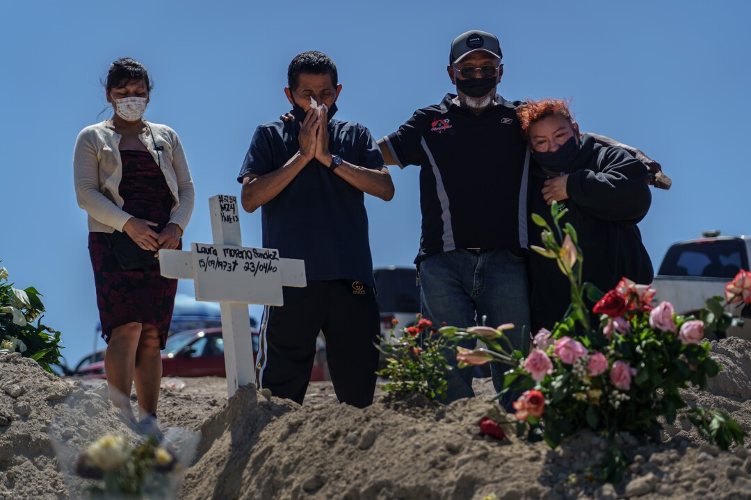 From left, Bernadina Cruz Perez, Fredy Villa Suerte Hernandez, Dominguez Hernandez and Cleotilde Hernandez mourn the death of Laura Moreno Sanchez, 49.