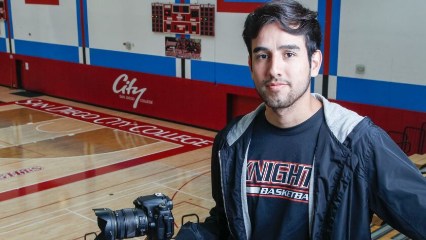 SDSU student David Pradel stands in the San Diego City College gym that sparked a documentary on the team that won the 2017 California junior-college championship.