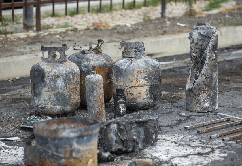 Propane tanks are part of the wreckage from a structure fire in Costa Mesa on Tuesday, June 2.