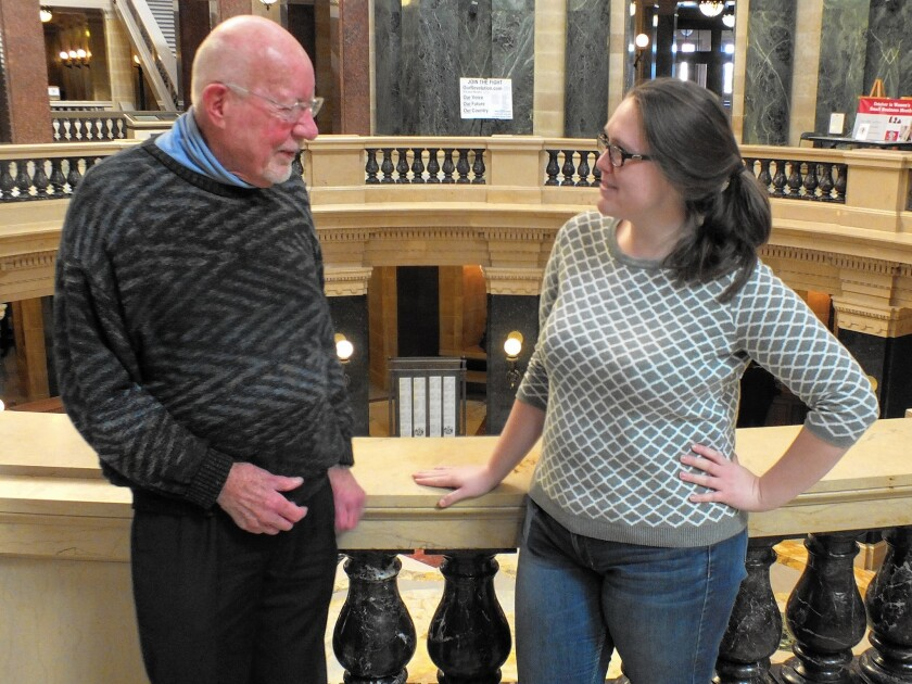 State Sen. Fred Risser (D-Madison) chats with aide Cassie Jurenci inside the Wisconsin State Capitol, where he has served as a legislator for six decades.