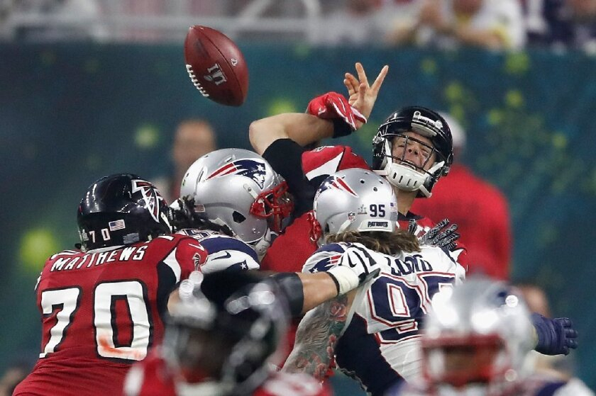Falcons quarterback Matt Ryan (2) is sacked by Patriots linebacker Dont'a Hightower (54) during the second half of Super Bowl 51 on Feb. 5.