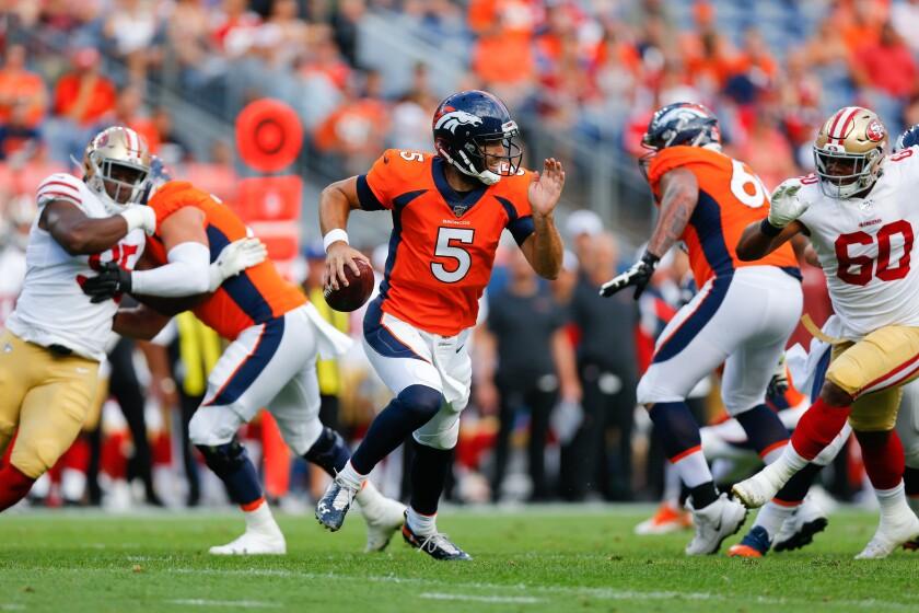Denver Broncos quarterback Joe Flacco scrambles against the San Francisco 49ers.