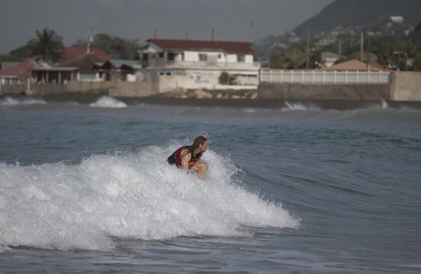 A man surfs at Wickie Wackie Beach before the arrival of Hurricane Matthew in Kingston, Jamaica, on Sunday.