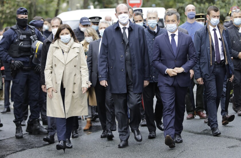 From the left, Paris mayor Anne Hidalgo, France Prime Minister Jean Castex, and Interior Minister Gerald Darmanin arrive on the scene after a knife attack near the former offices of satirical newspaper Charlie Hebdo, Friday Sept. 25, 2020 in Paris. French terrorism authorities are investigating a knife attack that wounded at least two people Friday near the former offices of the satirical newspaper Charlie Hebdo in Paris, authorities said. A suspect has been arrested. (AP Photo/Lewis Joly)