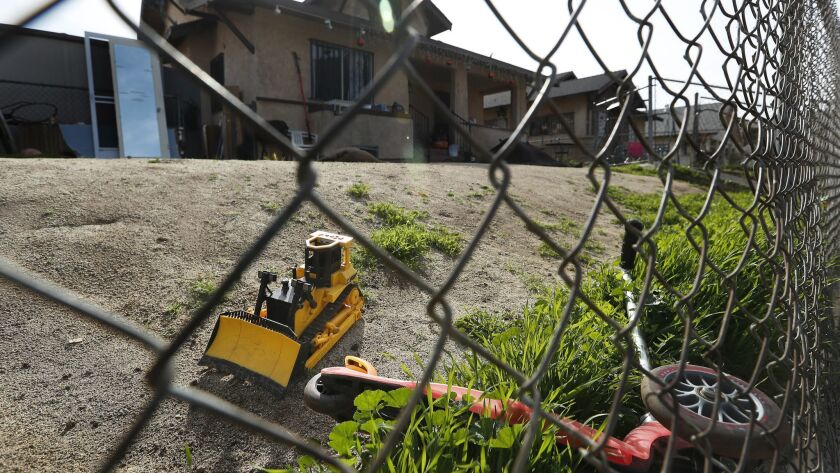 BOYLE HEIGHTS, CA-MARCH 19, 2018: Children's toys are seen in front yard of a home on Savina St. in