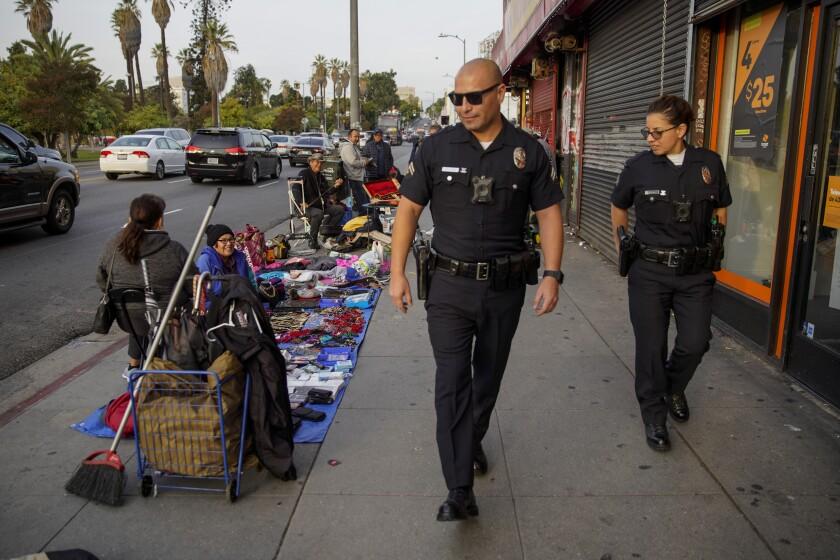 LAPD senior lead officers Robert Solorio and Iris Santin near MacArthur Park