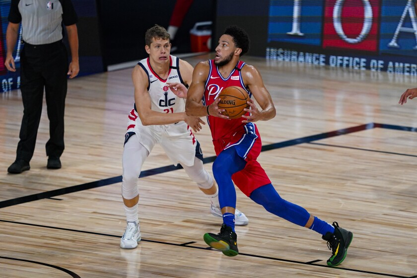 Philadelphia 76ers guard Ben Simmons drives on Washington Wizards forward Moritz Wagner.