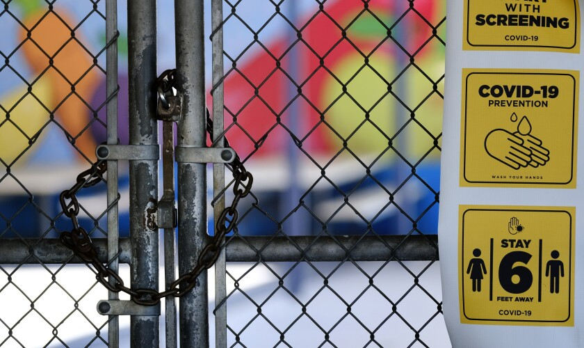 A gate is locked at a closed elementary school in July.