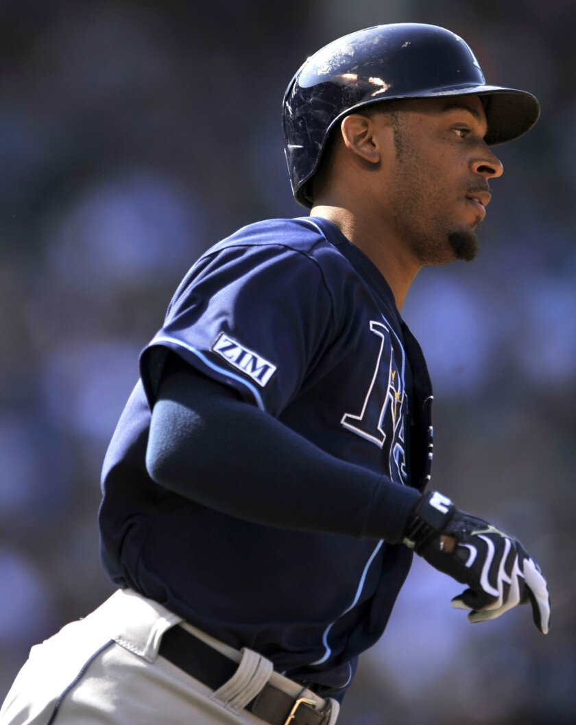 Tampa Bay Rays' Desmond Jennings watches his solo home run during the third inning of a baseball game against the Chicago Cubs in Chicago, Friday, Aug. 8, 2014. (AP Photo/Paul Beaty)