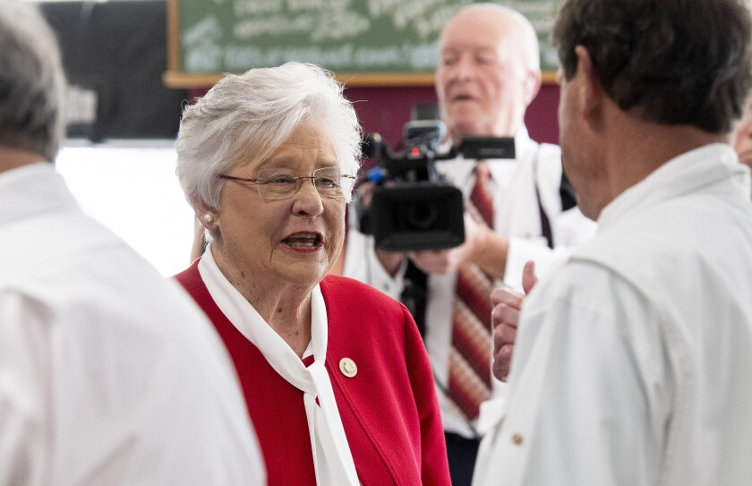 FILE - In this June 2, 2021 file photo, Alabama Gov. Kay Ivey talks with customers at Filet & Vine in Montgomery, Ala. Ivey has raised $1.2 million in her bid for reelection, her campaign announced the figure Thursday, June 30. (Mickey Welsh/The Montgomery Advertiser via AP)