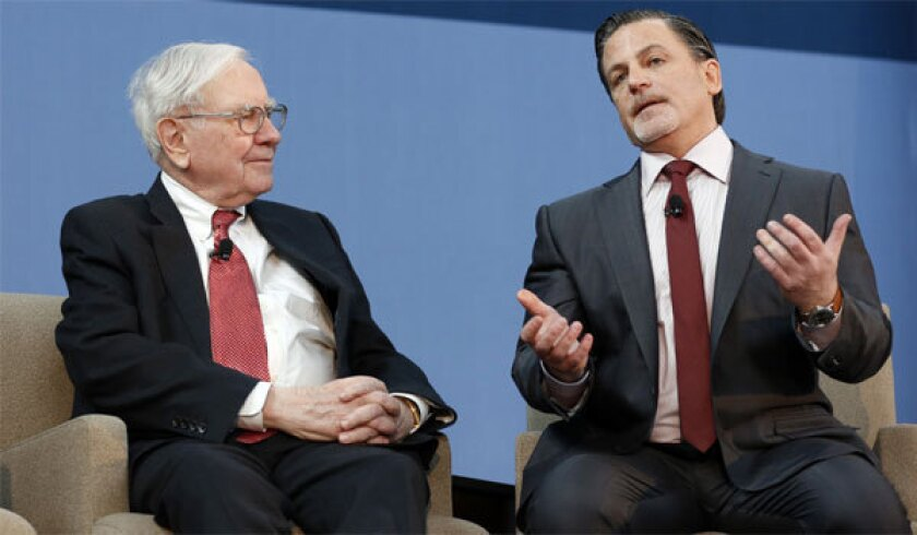 Warren Buffett, left, and Dan Gilbert have a billion-dollar idea to make March Madness even more fun.