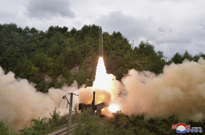 """This photo provided by the North Korean government Thursday, Sept. 16, 2021, shows a test missile is launched from a train on Sept. 15, 2021, in an undisclosed location of North Korea. North Korea says it succeeded in launching ballistic missiles from a train for the first time in part of continuing efforts to bolster its """"war deterrence,"""" a day after the two Koreas tested-fired missiles hours apart. Independent journalists were not given access to cover the event depicted in this image distributed by the North Korean government. The content of this image is as provided and cannot be independently verified. Korean language watermark on image as provided by source reads: """"KCNA"""" which is the abbreviation for Korean Central News Agency. (Korean Central News Agency/Korea News Service via AP)"""