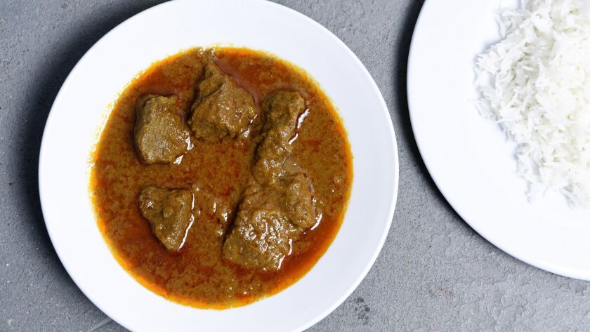 INGLEWOOD, CA-April 6, 2019: Beef Korma- beef stew cooked with homemade seasoning and a side of rice