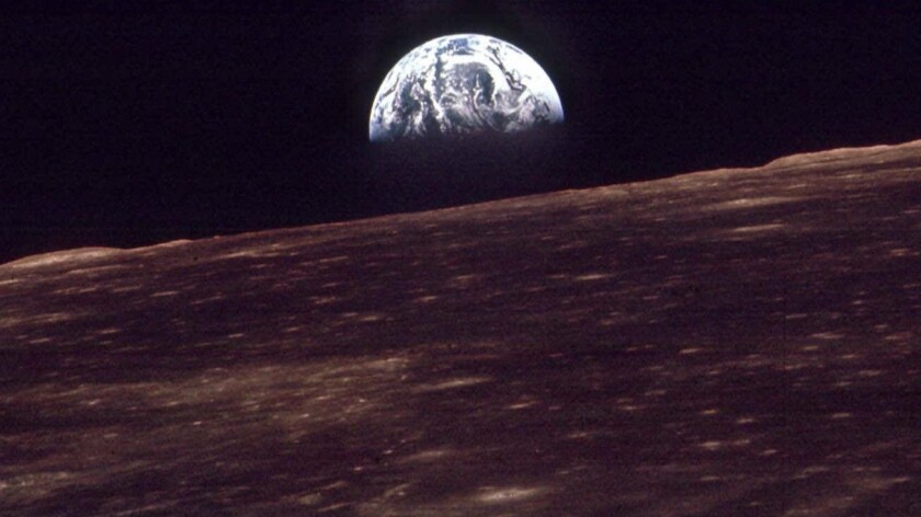 The Earth rises over the horizon of the moon in this Dec. 24, 1968, photo shot by an astronaut on Apollo 8.
