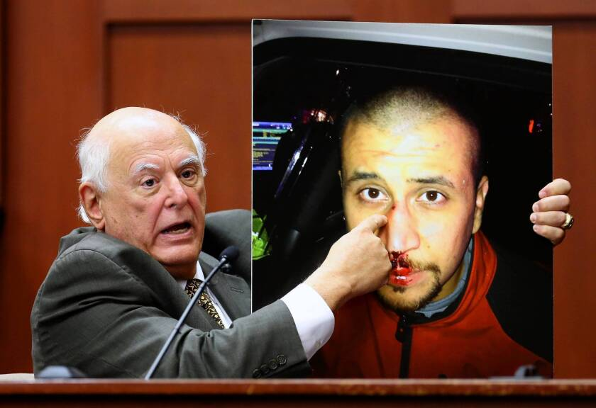 Martin was leaning over Zimmerman when shot, expert says