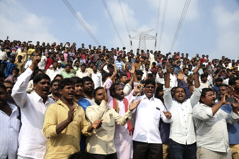 Hundreds gather Dec. 6 at a crime scene in Shadnagar, India, to show support for police after the fatal shootings of four suspects. The rape and murder of a 27-year-old woman has sparked protests across India.