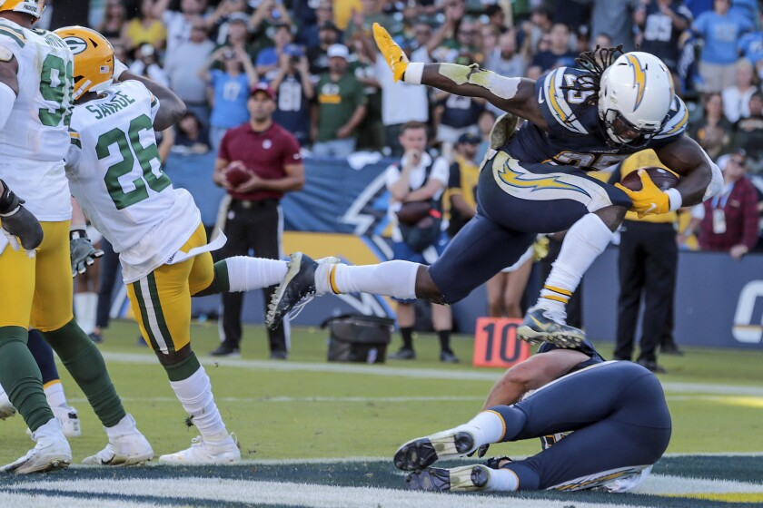 Chargers running back Melvin Gordon (25) leaps into the end zone for a third quarter touchdown against the Packers.