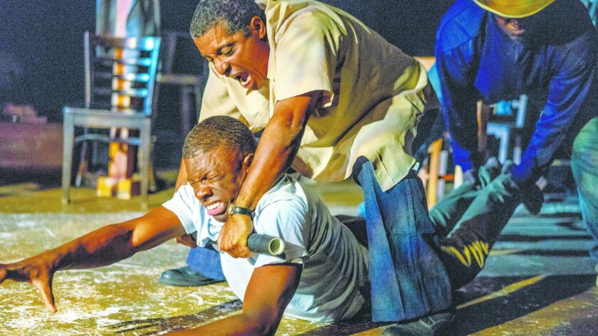 """Cortez L. Johnson (bottom), Rhys Greene and Dwaine Collier in """"The Ballad of Emmett Till"""" at Ion The"""