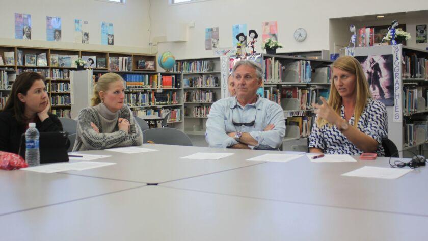 Bird Rock Elementary School principal Amanda Hale, teacher Jennifer Vick, Torrey Pines Elementary teacher Bruce Kent and principal Sarah Ott in discussion.