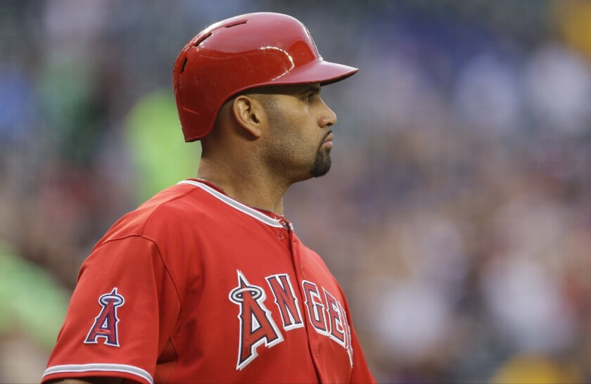 Albert Pujols got his first day off of the season Thursday as the Angels defeated the Seattle Mariners, 7-5, at Safeco Field.