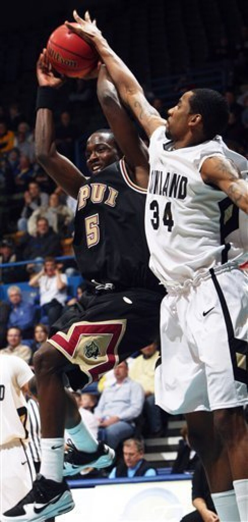 Oakland's Keith Benson blocks a shot attempt by IUPUI's Alex Young during the Summit League mens' championship NCAA college basketball game in Sioux Falls, S.D. at the Sioux Falls Arena on Tuesday, March 9, 2010. (AP Photo/Eric Landwehr)