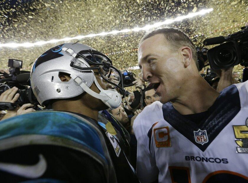 Carolina Panthers' Cam Newton, left, talks to Denver Broncos' Peyton Manning (18) after the NFL Super Bowl 50 football game Sunday, Feb. 7, 2016, in Santa Clara, Calif. The Broncos won 24-10. (AP Photo/David J. Phillip)