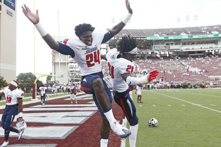 South Alabama cornerbacks Darian Mills (24) and Quinton Dent (21) celebrate their 21-20 win over Mississippi State in an NCAA college football game in Starkville, Miss., Saturday, Sept. 3, 2016. (AP Photo/Rogelio V. Solis)