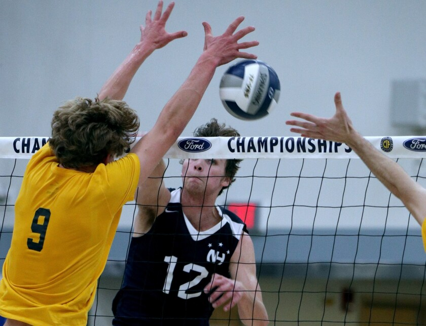 Newport Harbor High School's Dayne Chalmers spikes the ball in the CIF-SS Boys' Volleyball Division