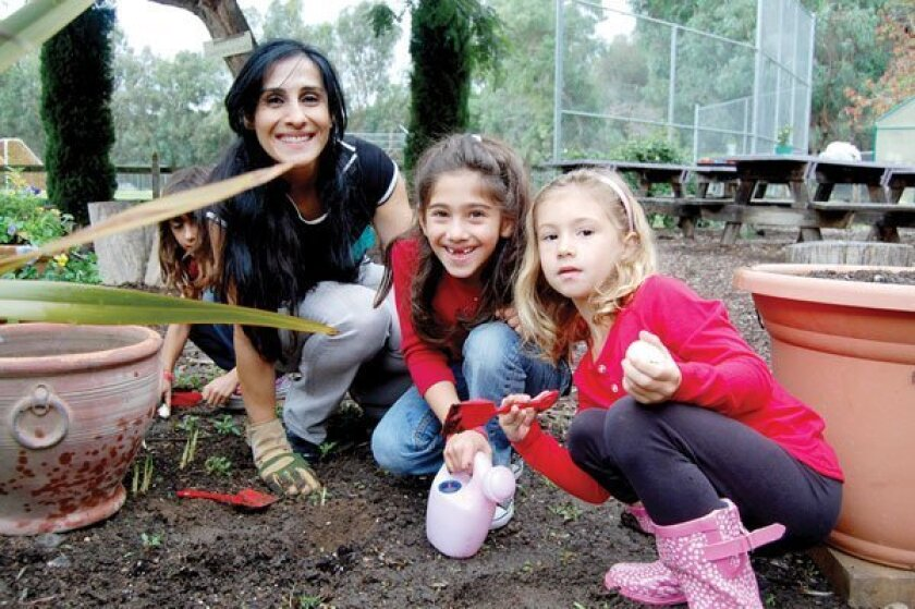 Garden volunteer Mahbod Ghods, Elina Ghods and Mia Lingenbrink.