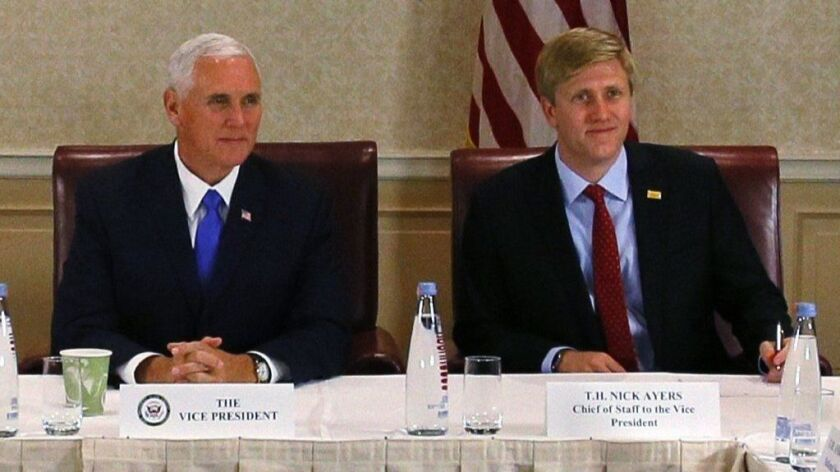 Vice President Mike Pence, left, attends a meeting in Georgia last year with his chief of staff, Nick Ayers.
