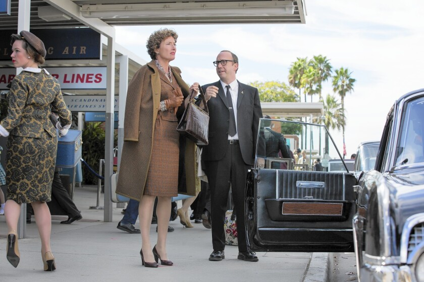 "P.L. Travers (Emma Thompson) and Ralph (Paul Giamatti) in ""Saving Mr. Banks."""