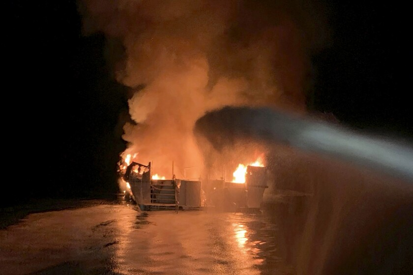 FILE - In this Sept. 2, 2019, file photo, provided by the Ventura County Fire Department, VCFD firefighters respond to a fire aboard the Conception dive boat fire in the Santa Barbara Channel off the coast of Southern California. Federal lawmakers introduced legislation Wednesday, Sept. 22, 2021, that would change 19th century maritime liability rules in response to the 2019 boat fire off the coast of Southern California that killed 34 people. (Ventura County Fire Department via AP, File)