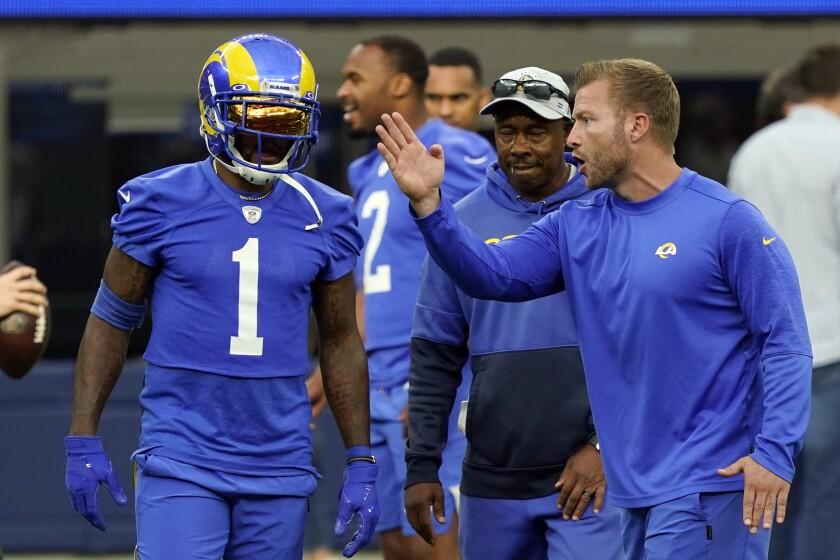 Rams coach Sean McVay talks to wide receiver DeSean Jackson.