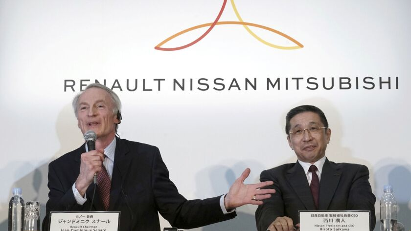 Renault Chairman Jean-Dominique Senard, left, speaks as then-Nissan CEO Hiroto Saikawa listens during a joint news conference at the Nissan headquarters in Yokohama earlier this year. Saikawa has since resigned.