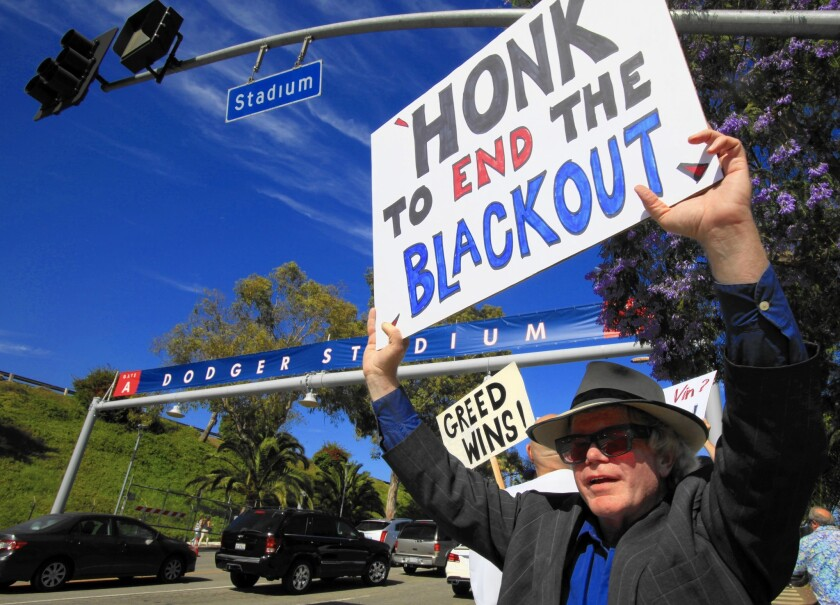 Bill Peterson of Los Angeles and about 25 others protest the TV blackout outside Dodger Stadium in 2015.