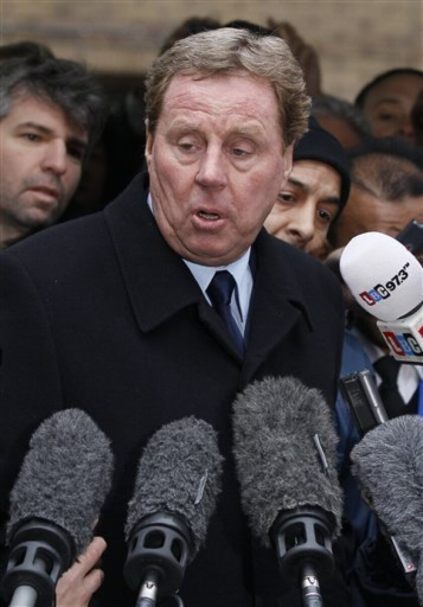 Tottenham Hotspur football club manager Harry Redknapp delivers a statement outside Southwark Crown Court in London, Wednesday, Feb. 8, 2012. Tottenham manager Harry Redknapp was cleared of tax evasion Wednesday, removing a key barrier to his chances of becoming the next England coach. (AP Photo/Kirsty Wigglesworth)