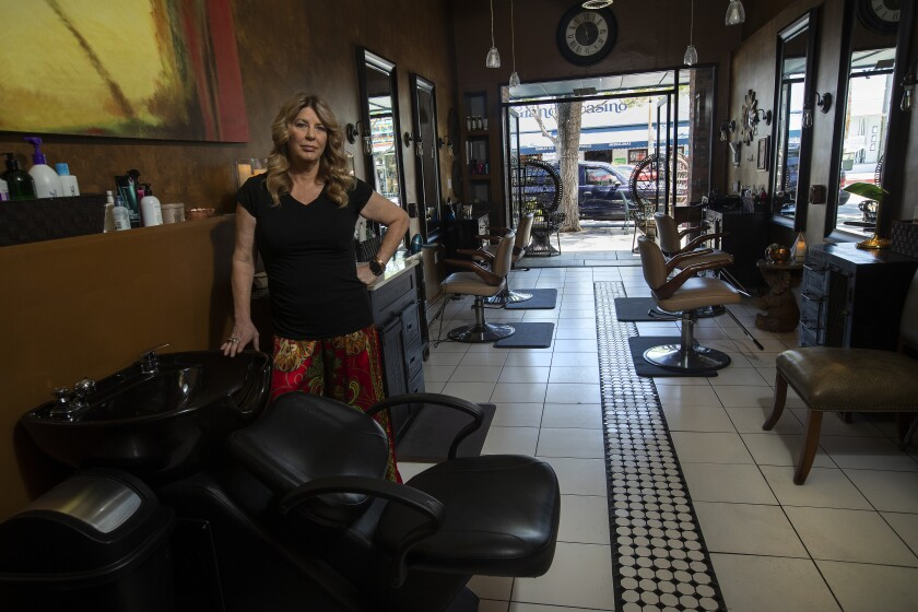 Elaina Wilcox, owner of Color & Craft Salon, in her empty Culver City salon on May 6.