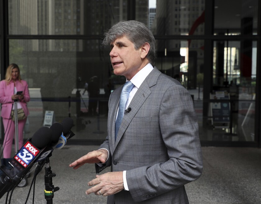 """Former Illinois Gov. Rod Blagojevich holds a news conference outside a federal courthouse in Chicago on Monday, Aug. 2, 2021. Blagojevich sued his home state Monday for booting him from the governor's seat after his 2008 arrest for corruption and stripping him of his right to run for elective office in Illinois. Before filing the lawsuit, an unapologetic Blagojevich addressed reporters outside the same federal courthouse in Chicago where he was convicted, declaring: """"I'm back."""" He said he hasn't decided, however, if he will seek to run for anything if he succeeds in eliminating the legal hurdles to doing so. (Terrence Antonio James/Chicago Tribune via AP)"""