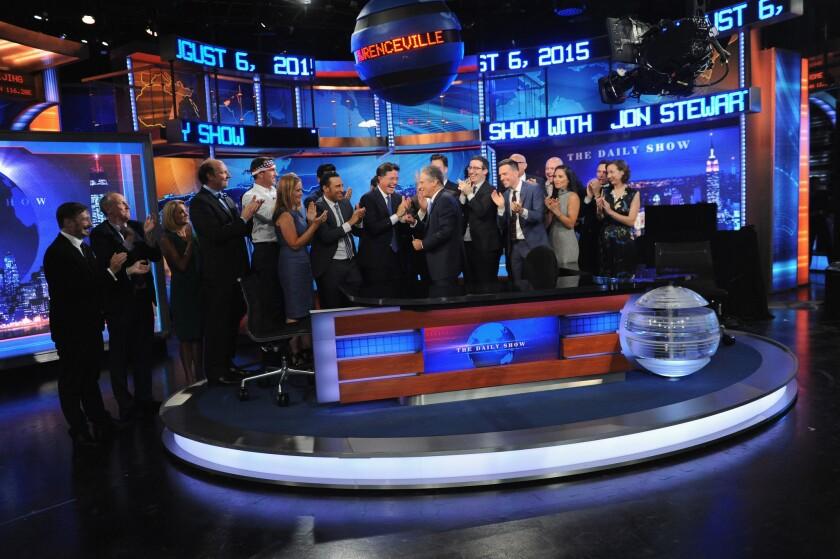 "John Hodgman, Matt Walsh, Nancy Walls, Dan Bakkedahl, Rob Riggle, Samantha Bee, Aasif Mandvi, Stephen Colbert, Jon Stewart, Jordan Klepper, John Oliver, Ed Helms, Larry Wilmore, Rob Corddry, Olivia Munn, and Kristen Schaal appear on ""The Daily Show with Jon Stewart"" on Aug. 6."